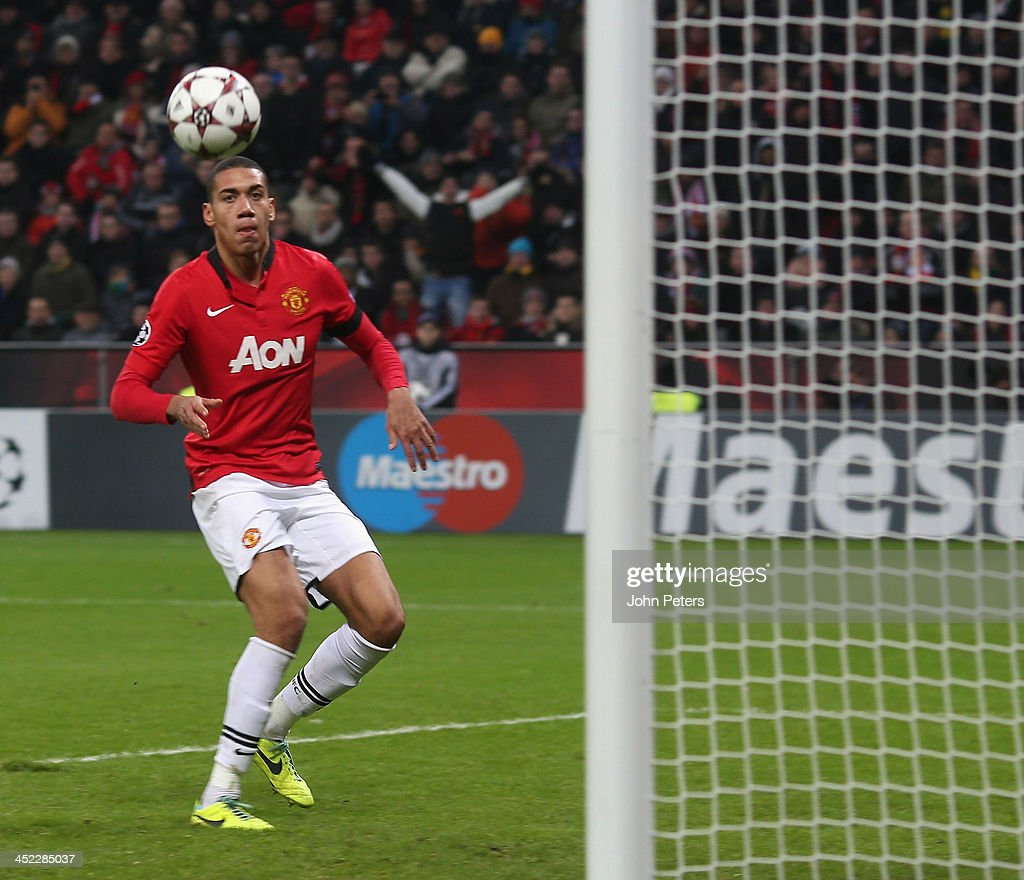 <a gi-track='captionPersonalityLinkClicked' href=/galleries/search?phrase=Chris+Smalling&family=editorial&specificpeople=5964313 ng-click='$event.stopPropagation()'>Chris Smalling</a> of Manchester United scores their fourth goal during the UEFA Champions League Group A match between Bayer Leverkusen and Manchester United at BayArena on November 27, 2013 in Leverkusen, North Rhine-Westphalia.