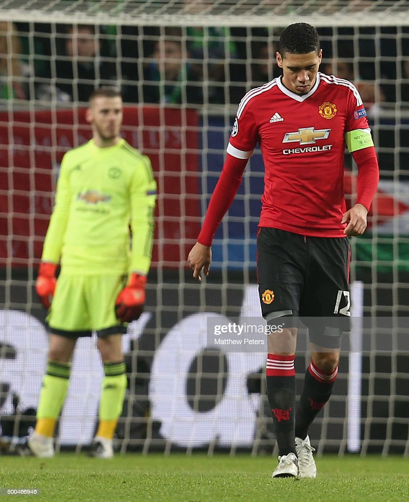 Chris Smalling of Manchester United shows his disappointment during the UEFA Champions League match between VfL Wolfsburg and Manchester United at Volkswagen Arena on December 8, 2015 in Wolfsburg, Germany.