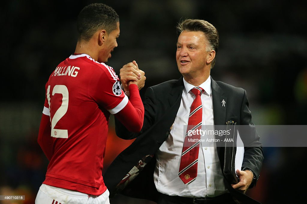 Chris Smalling of Manchester United who scored the winning goal gets congratulated by Louis van Gaal the head coach / manager of Manchester United at the end of the UEFA Champions League match between Manchester United and Wolfsburg at Old Trafford on September 30, 2015 in Manchester, United Kingdom.