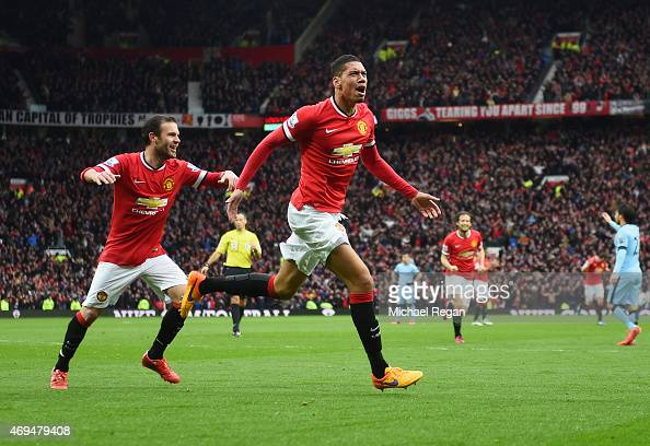 Chris Smalling of Manchester United with celebrates with Juan Mataas he scores their fourth goal during the Barclays Premier League match between...
