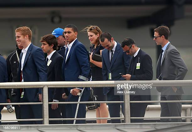 Chris Smalling Ryan Giggs and Jonny Evans of Manchester United watch horse racing at Chester Racecourse on May 8 2013 in Chester England