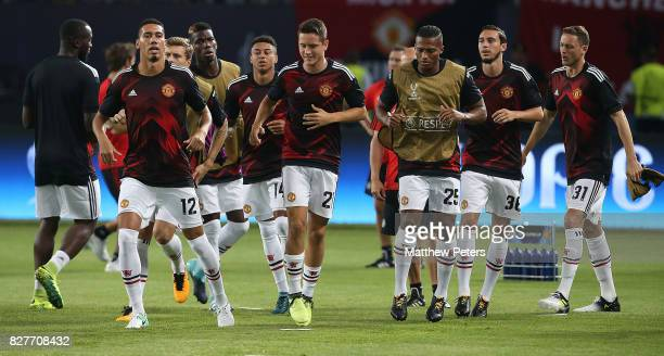 Chris Smalling Victor Lindelof Ander Herrera Antonio Valencia and Matteo Darmian of Manchester United warm up ahead of the UEFA Super Cup match...