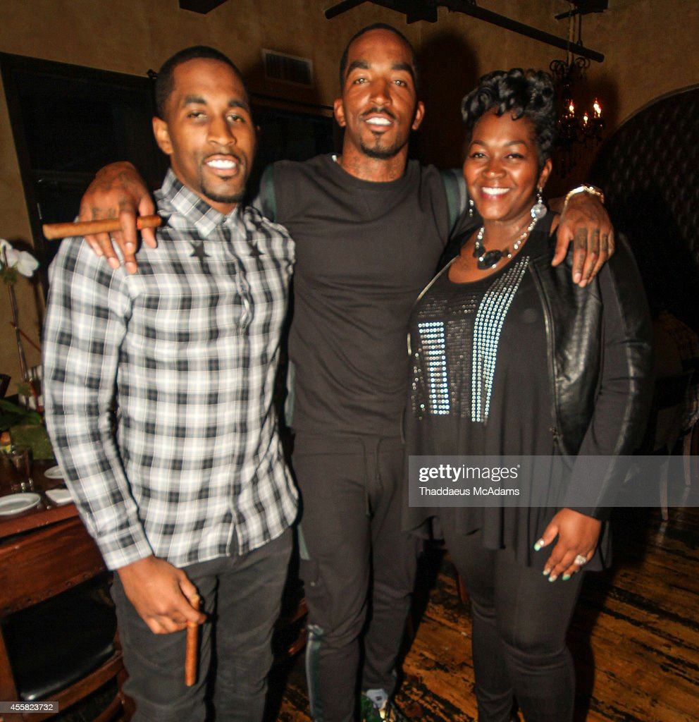 Chris Smith JR Smith and Stephanie Smith attends the birthday dinner for JR Smith at S Prime on September 9 2014 in Astoria New York