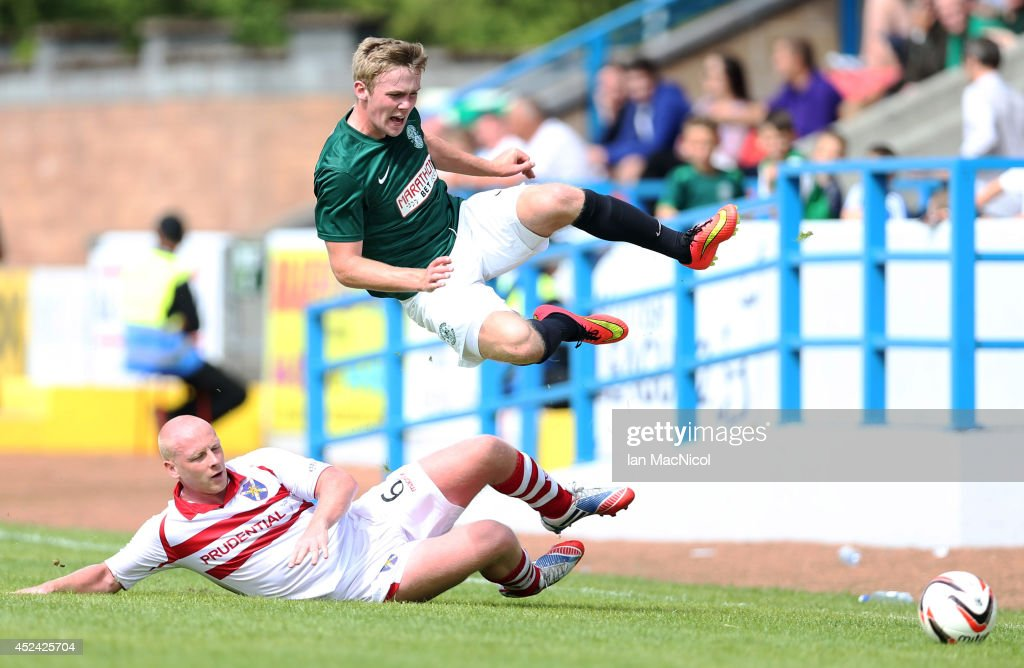 Chris Smith of Stirling Albion vies with Lewis Allan of Hibernian during the Pre Season Friendly match between Stirling Albion and Hibernian at Forthbank Stadium on July 20, 2014 in Stirling, Scotland.