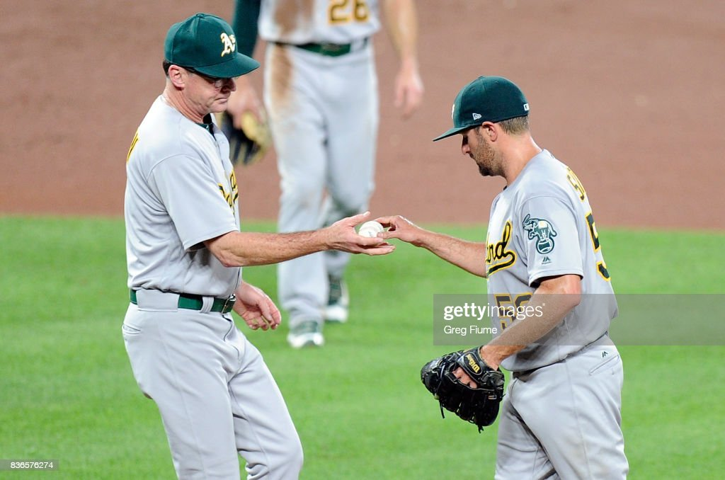 Chris Smith #56 of the Oakland Athletics is taken out of the game by manager Bob Melvin #6 in the fifth inning against the Baltimore Orioles at Oriole Park at Camden Yards on August 21, 2017 in Baltimore, Maryland.