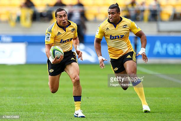 Chris Smylie of the Hurricanes makes a break with Julian Savea in support during the round five Super Rugby match between the Hurricanes and the...