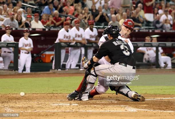 Chris Snyder of the Arizona Diamondbacks collides with catcher Brett Hayes of the Florida Marlins as he slides in to score a run during the fourth...