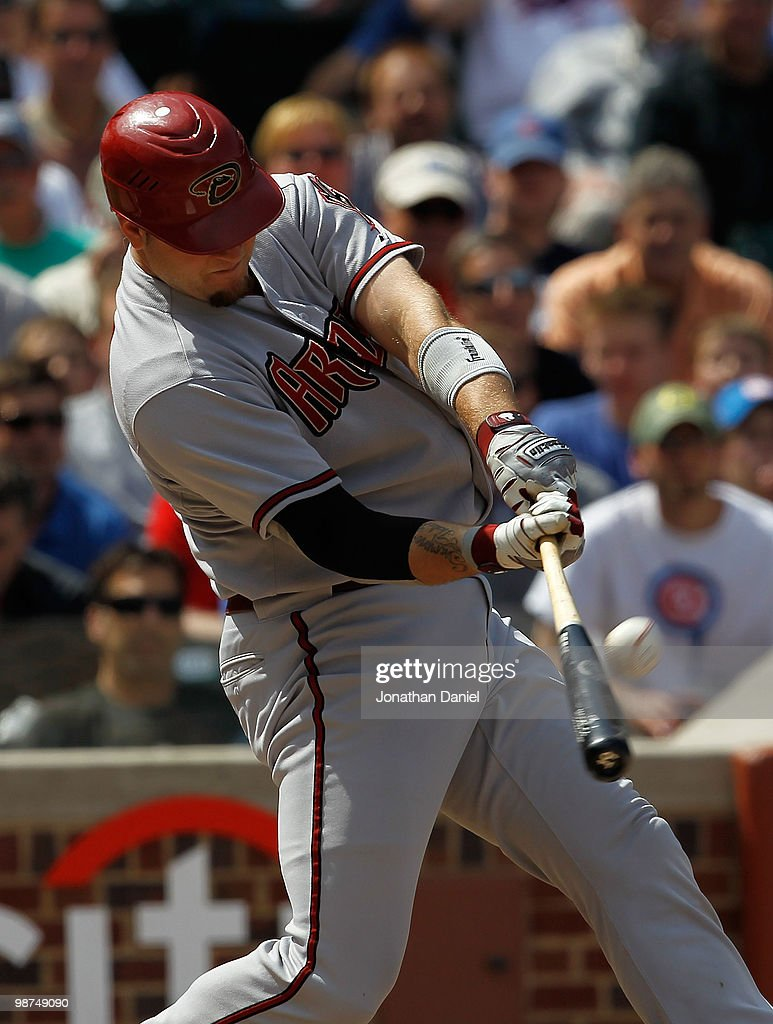 Chris Snyder #19 of the Arizona Diamondbacks hits a two-run home run in the 4th inning against the Chicago Cubs at Wrigley Field on April 29, 2010 in Chicago, Illinois.