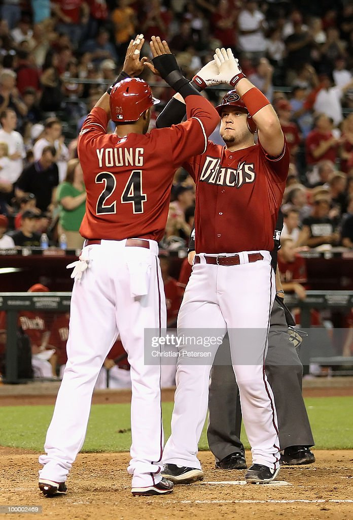 Chris Snyder #19 of the Arizona Diamondbacks is congratulated by teammate Chris Young #24 after hitting a 2 run home run against the San Francisco Giants during the sixth inning of the Major League Baseball game at Chase Field on May 19, 2010 in Phoenix, Arizona.
