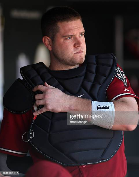 Chris Snyder of the Arizona Diamondbacks puts on his catcher's gear in the dugout during the game between the Arizona Diamondbacks and the San...