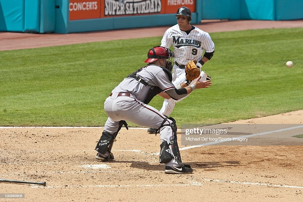 Chris Snyder #19 of the Arizona Diamondbacks waits for the ball as Brett Hayes of the Florida Marlins runs home during a MLB game in Sun Life Stadium on May 18, 2010 in Miami, Florida.