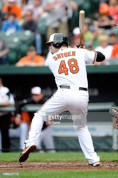 Chris Snyder of the Baltimore Orioles bats against the Tampa Bay Rays at Oriole Park at Camden Yards on May 19 2013 in Baltimore Maryland