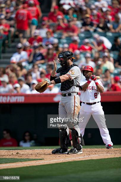 Chris Snyder of the Baltimore Orioles calls signals while he catches during the game against the Los Angeles Angels of Anaheim on May 4 2013 at Angel...