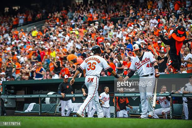 Chris Snyder of the Baltimore Orioles greets Chris Dickerson during a game against the Detroit Tigers at Oriole Park at Camden Yards on June 2 2013...