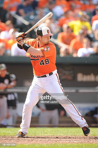 Chris Snyder of the Baltimore Orioles prepares for a pitch during a baseball game against the Chicago White Sox on September 7 2013 at Oriole Park at...