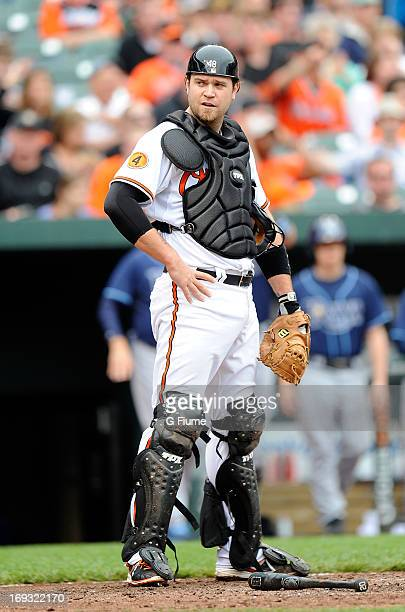 Chris Snyder of the Baltimore Orioles rests during a break in the game against the Tampa Bay Rays at Oriole Park at Camden Yards on May 19 2013 in...