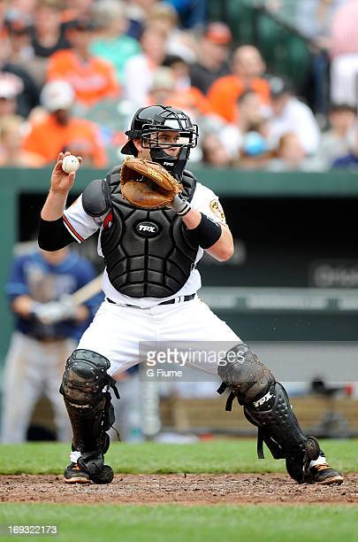 Chris Snyder of the Baltimore Orioles throws the ball to second base against the Tampa Bay Rays at Oriole Park at Camden Yards on May 19 2013 in...