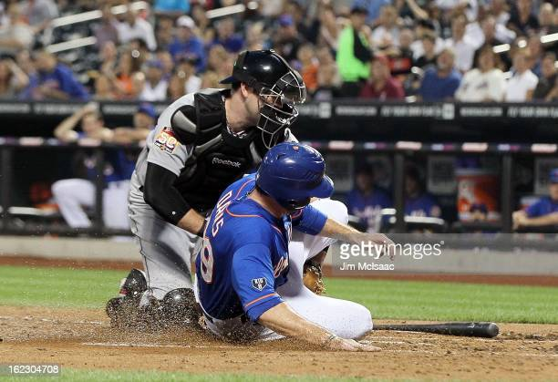 Chris Snyder of the Houston Astros in action against Ike Davis of the New York Mets at Citi Field on August 24 2012 in the Flushing neighborhood of...