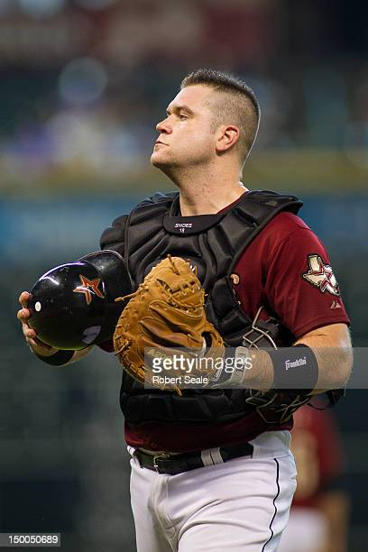 Chris Snyder of the Houston Astros looks on during the game against the Pittsburgh Pirates on Sunday July 29 2012 at Minute Maid Park in Houston...
