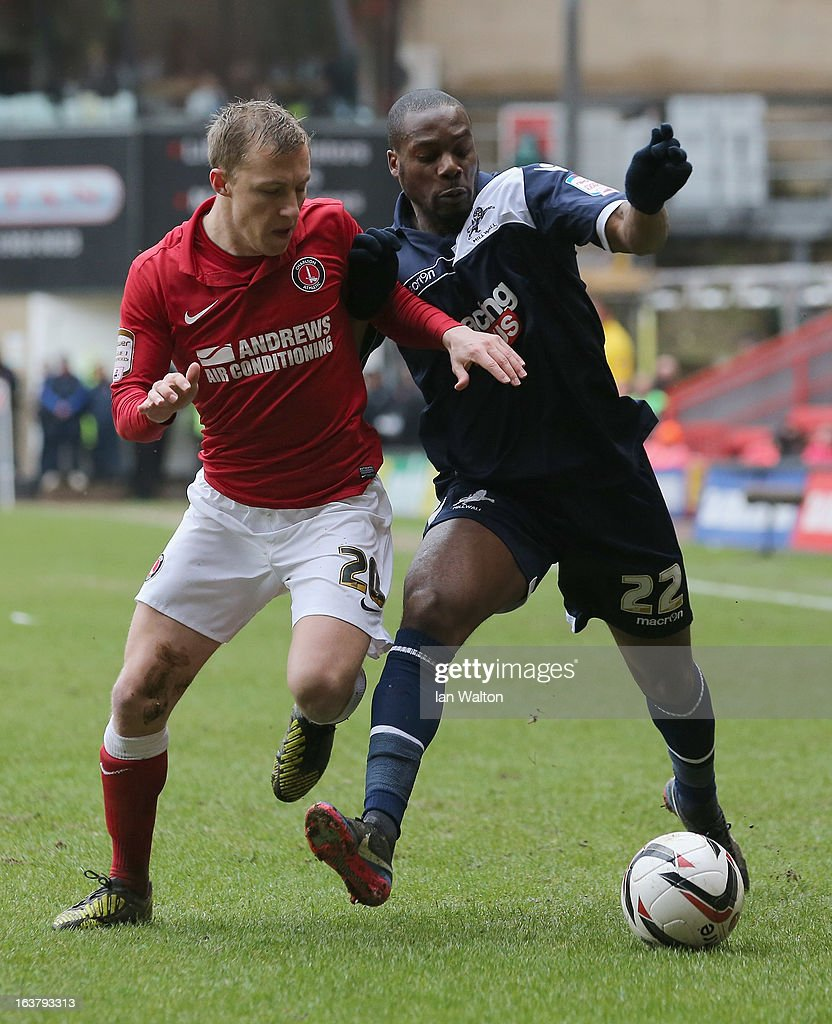 Chris Solly of Charlton Athletic tries to tackle Dany N'Guessan of Millwall during the npower Championship match between Charlton Athletic and Millwall at The Valley on March 16, 2013 in London, England.