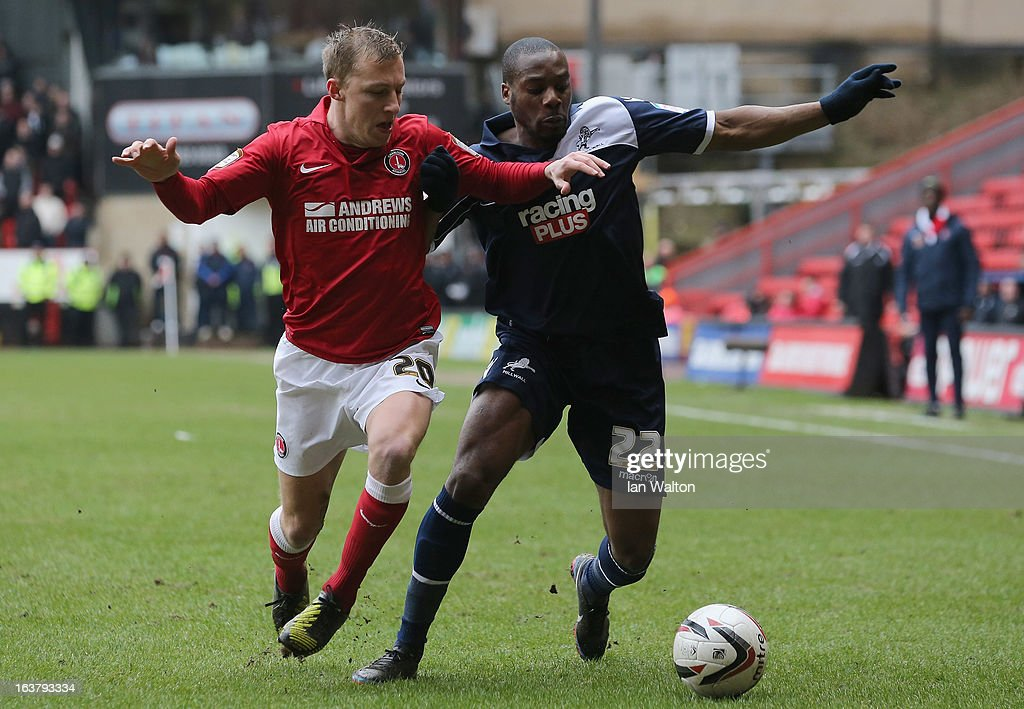 Chris Solly (L) of Charlton Athletic tries to tackle Dany N'Guessan of Millwall during the npower Championship match between Charlton Athletic and Millwall at The Valley on March 16, 2013 in London, England.
