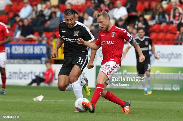 Chris Solly of Charlton plays the ball watched by Daniel Powell of Northampton Town during the Sky Bet League One match between Charlton Athletic and...
