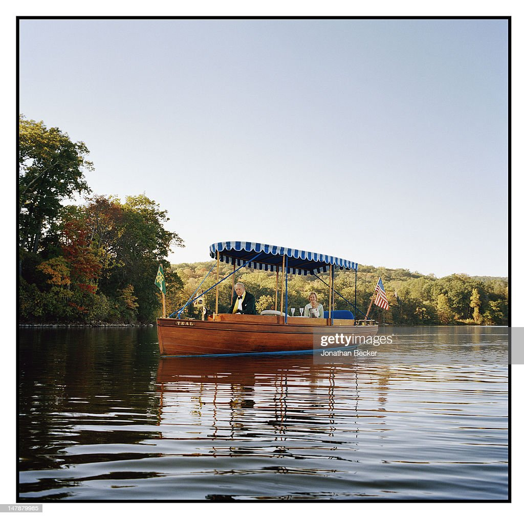 Chris Sonne, town historian and wife Sally Sonne are photographed for Town & Country Magazine on September 8, 2011 in their 1097 Elco Electric ferry in Tuxedo Park, New York. PUBLISHED IMAGE.