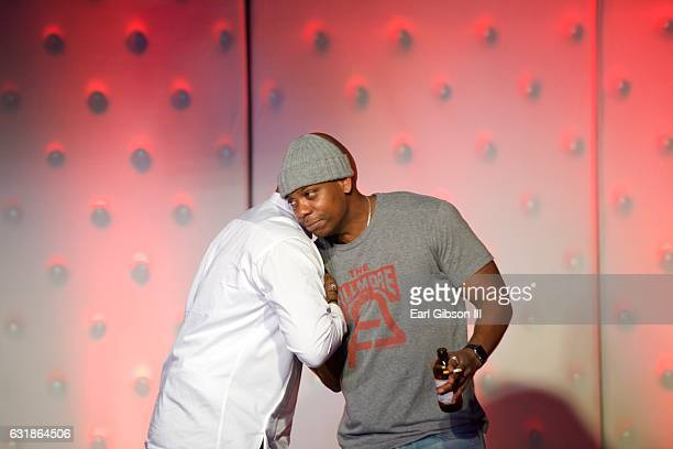 Chris Spencer and Dave Chappelle share the stage at the Birthday Celebration for Chris Spencer at The Savoy Entertainment Center on January 16 2017...