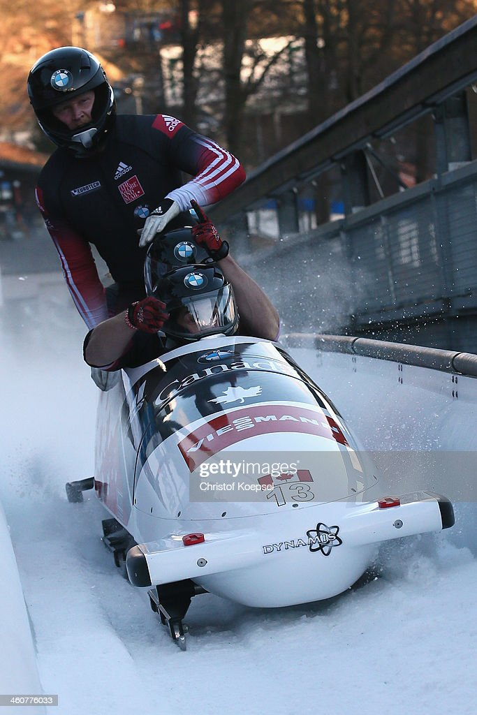 Chris Spring Jesse Lumsden Cody Sorensen and Ben Coakwell of Canada compete in their second run of the four man bob competition during the FIBT Bob...