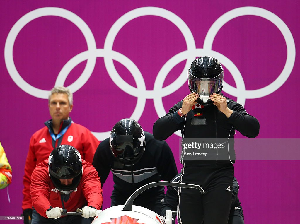 Chris Spring of Canada and his crew prepare to start during a fourman bobsleigh practice session on Day 14 of the Sochi 2014 Winter Olympics at...