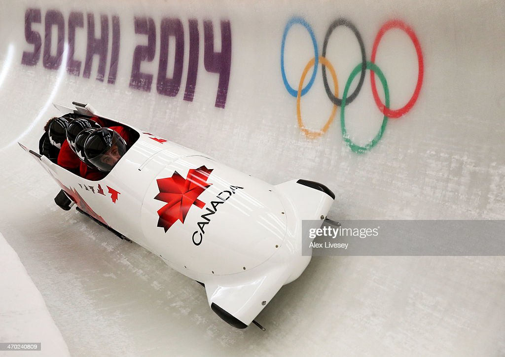 Chris Spring of Canada pilots a run during a fourman bobsleigh practice session on Day 12 of the Sochi 2014 Winter Olympics at Sliding Center Sanki...