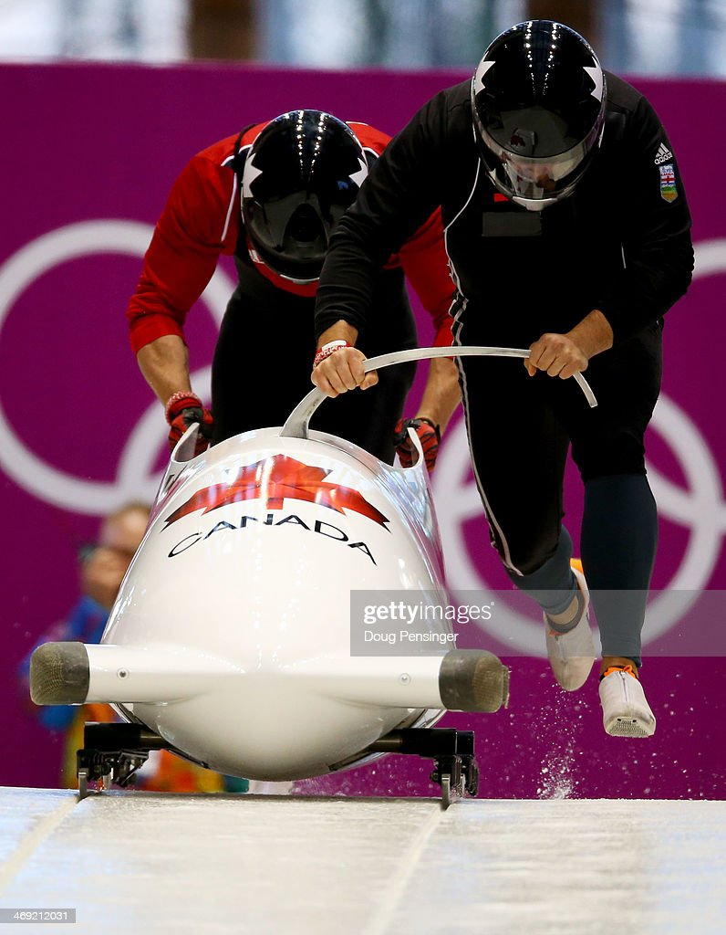 Chris Spring of Canada pilots a run during a Men's Twoman Bobsleigh training session on day 6 of the Sochi 2014 Winter Olympics at the Sanki Sliding...