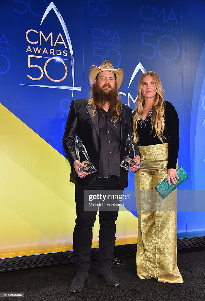 Chris Stapleton and Morgane Stapleton pose with the award for Male Vocalist of the Year and Video of the Year at the 50th annual CMA Awards at the Bridgestone Arena on November 2, 2016 in Nashville, Tennessee.