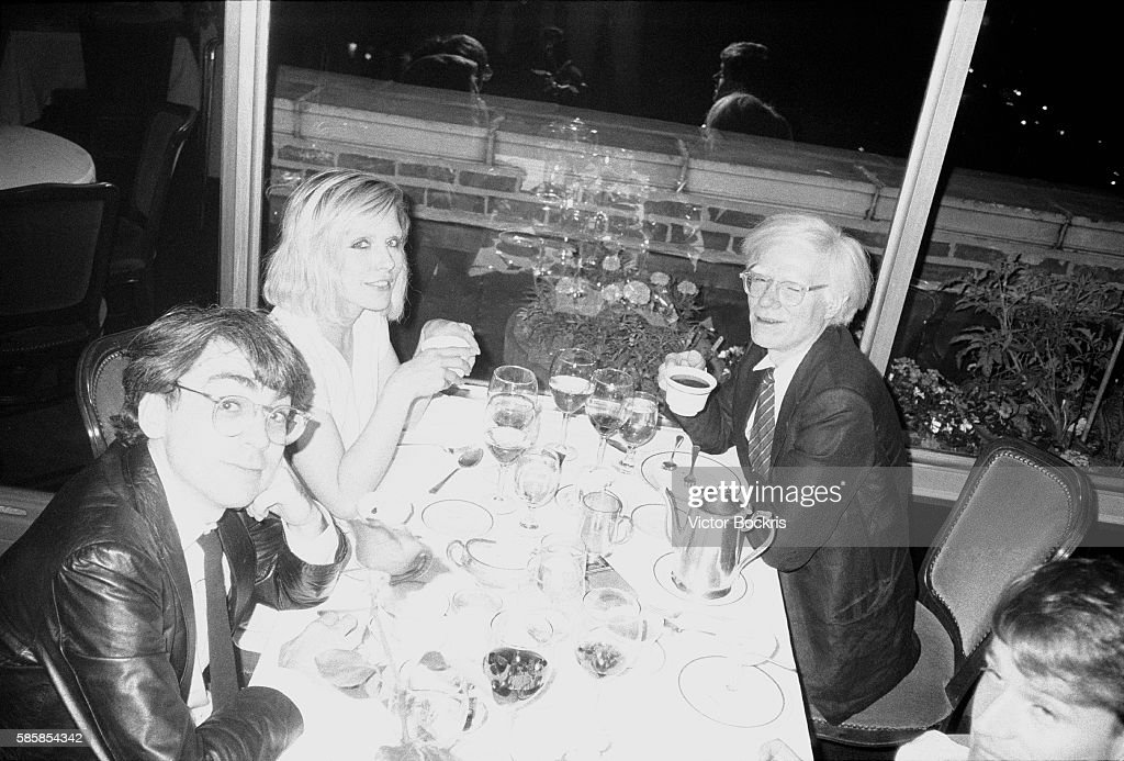 Chris Stein, Debbie Harry and Andy Warhol at a restaurant in Harlem.