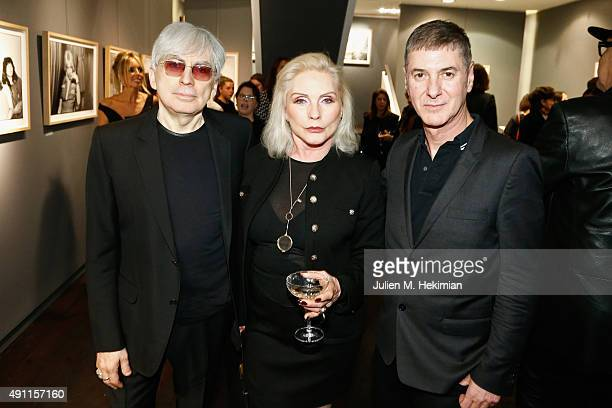 Chris Stein Debbie Harry and Etienne Daho attend the Chris Stein 'Negative' Exhibition Opening at Galerie Agnes Monplaisir on October 3 2015 in Paris...