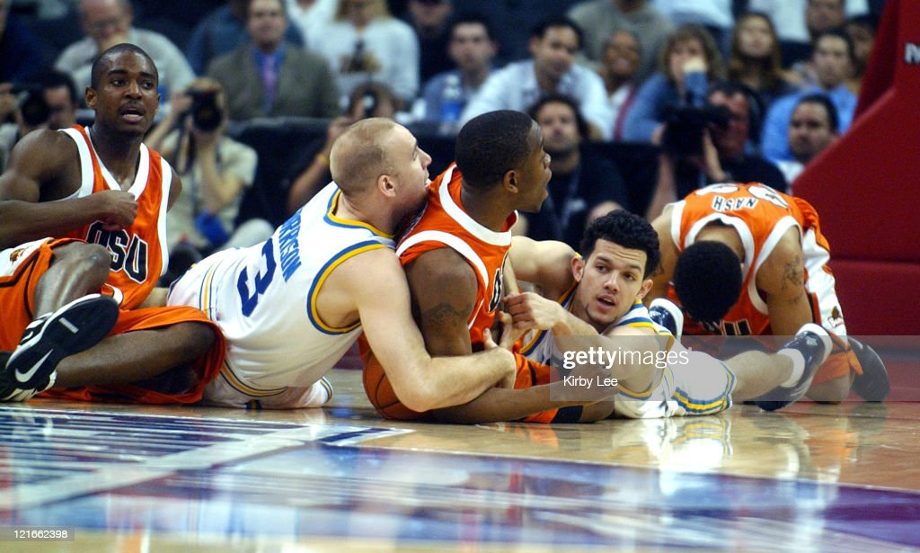 Chris Stephens of Oregon State (center) battles for loose ball with UCLA's Brian Morrison (left) and <a gi-track='captionPersonalityLinkClicked' href=/galleries/search?phrase=Jordan+Farmar&family=editorial&specificpeople=228137 ng-click='$event.stopPropagation()'>Jordan Farmar</a> (right) during 79-72 first-round victory in the Pacific Life Pac-10 men's basketball tournament at the Staples Center in Los Angeles, California on Thursday, March 10, 2005.