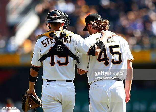 Chris Stewart and Gerrit Cole of the Pittsburgh Pirates talk on the mound against the Chicago Cubs during game one of the doubleheader at PNC Park on...