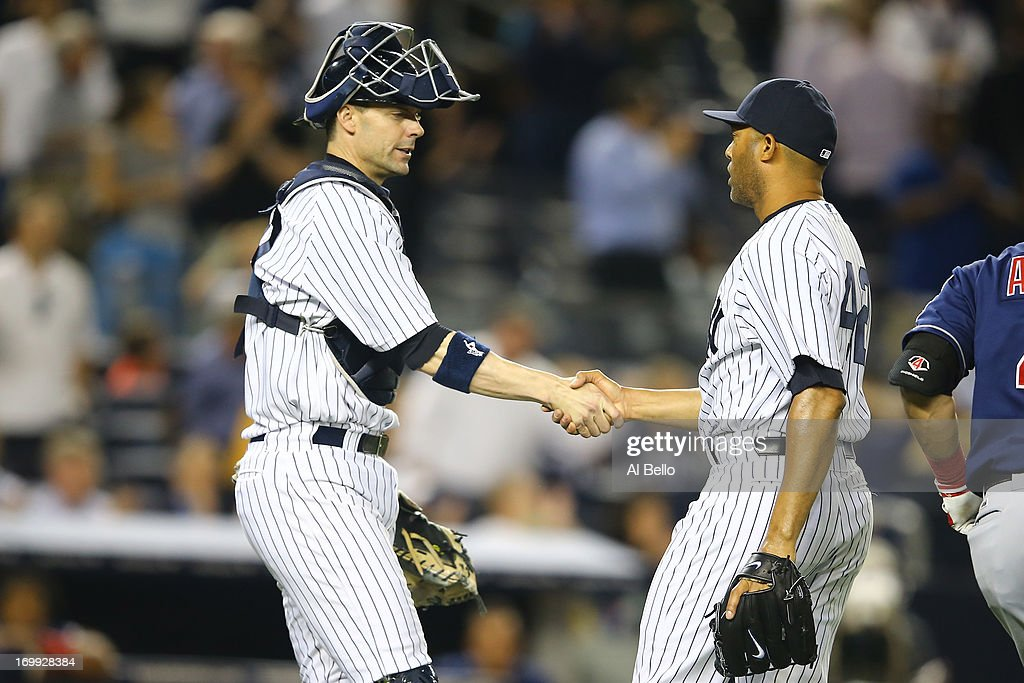Chris Stewart #19 and <a gi-track='captionPersonalityLinkClicked' href=/galleries/search?phrase=Mariano+Rivera&family=editorial&specificpeople=201607 ng-click='$event.stopPropagation()'>Mariano Rivera</a> #42 of the New York Yankees celebrate a 4-3 win against the Cleveland Indians during their game on June 4, 2013 at Yankee Stadium in the Bronx borough of New York City