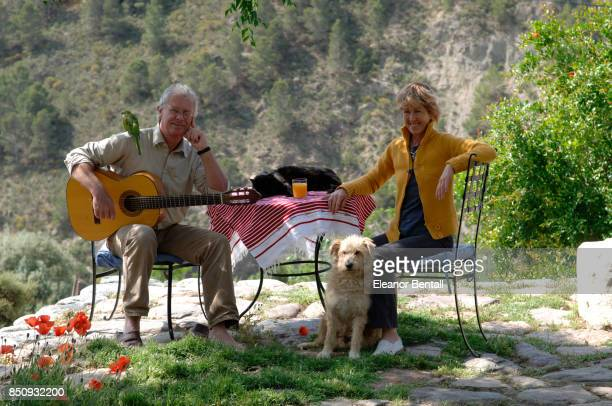 Chris Stewart British writer and former drummer and founder member of Genesis at his home El Valero in Las Alpujarras Andalucia Spain On terrace with...