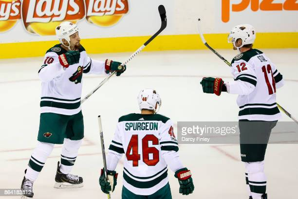 Chris Stewart Jared Spurgeon and Eric Staal of the Minnesota Wild celebrate a first period goal against the Winnipeg Jets at the Bell MTS Place on...