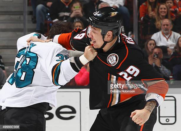 Chris Stewart of the Anaheim Ducks fights against Micheal Haley of the San Jose Sharks on December 4 2015 at Honda Center in Anaheim California