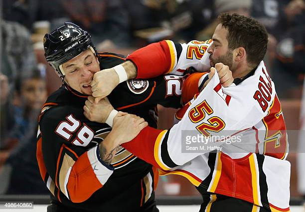 Chris Stewart of the Anaheim Ducks fights with Brandon Bollig of the Calgary Flames during the first period of a game at Honda Center on November 24...