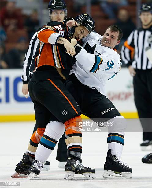 Chris Stewart of the Anaheim Ducks fights with Michael Haley of the San Jose Sharks during a game at Honda Center on December 4 2015 in Anaheim...