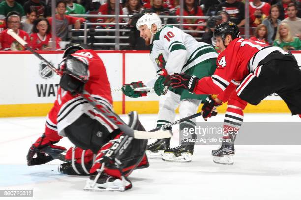 Chris Stewart of the Minnesota Wild scores on goalie Corey Crawford of the Chicago Blackhawks in the third period at the United Center on October 12...