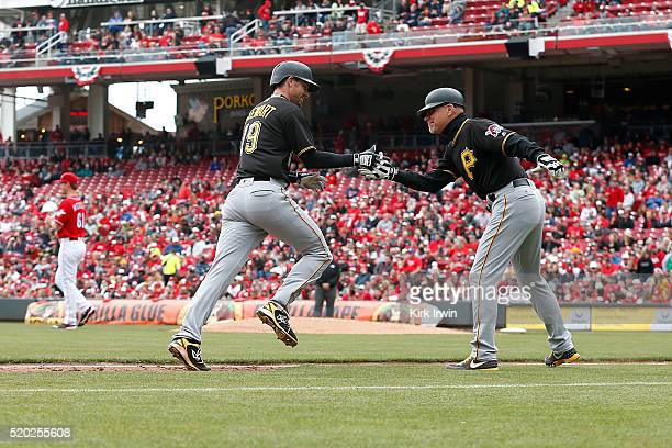 Chris Stewart of the Pittsburgh Pirates is congratulated by Third Base Coach Rick Sofield of the Pittsburgh Pirates after hitting a solo home run...