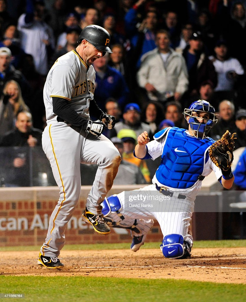 Chris Stewart of the Pittsburgh Pirates reacts after scoring as Miguel Montero of the Chicago Cubs makes a late tag during the sixth inning on April...