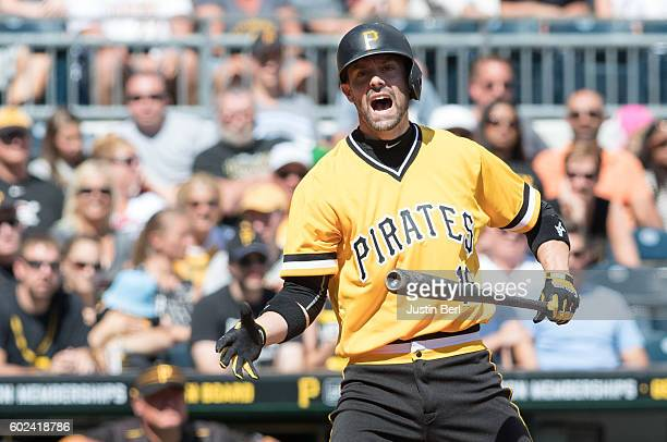 Chris Stewart of the Pittsburgh Pirates reacts after striking out in the second inning during the game against the Cincinnati Reds at PNC Park on...