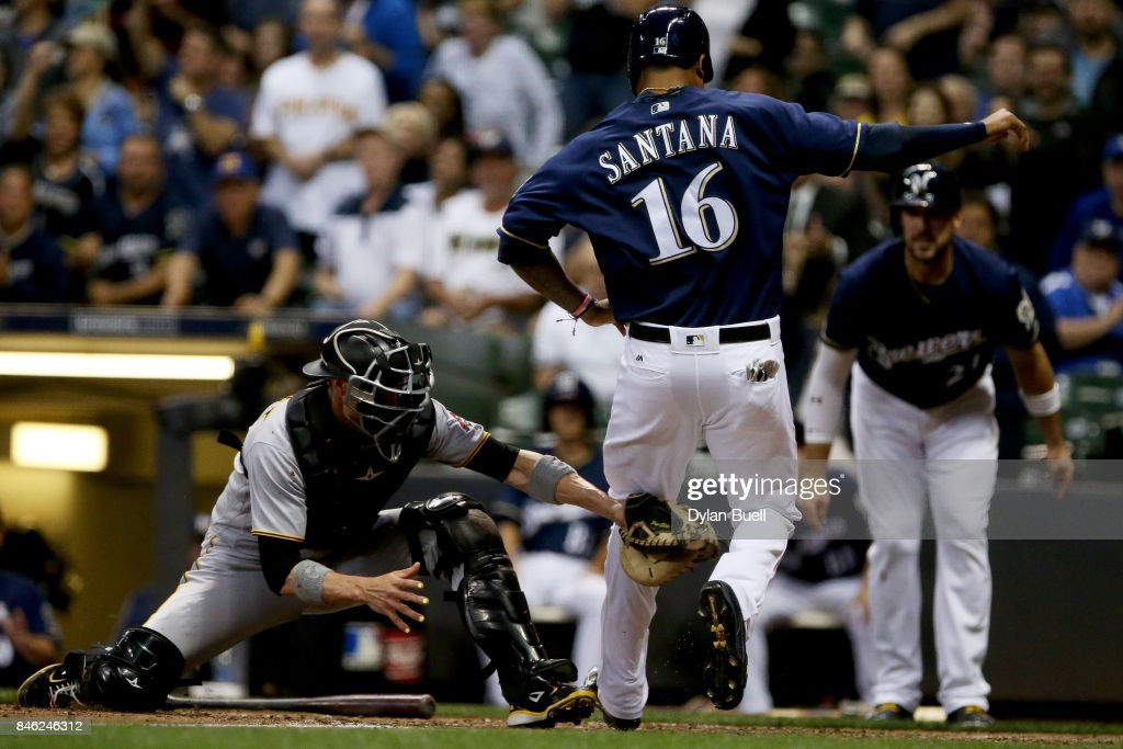 Chris Stewart #19 of the Pittsburgh Pirates tags out Domingo Santana #16 of the Milwaukee Brewers at home plate in the third inning at Miller Park on September 12, 2017 in Milwaukee, Wisconsin.