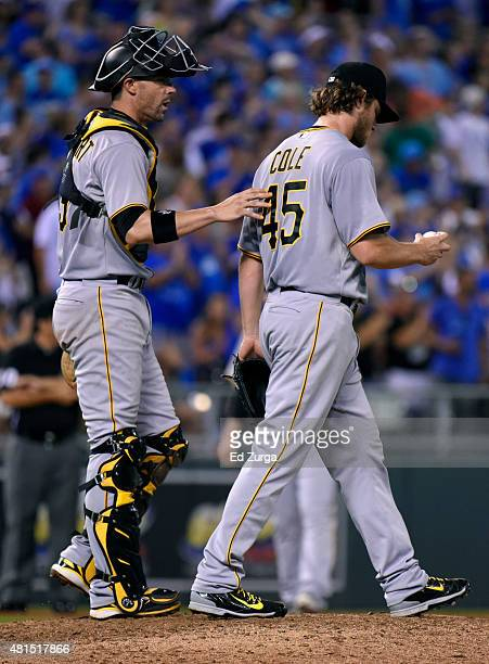 Chris Stewart of the Pittsburgh Pirates talks with Gerrit Cole after Cole gave up a single to Alex Rios of the Kansas City Royals in the eighth...