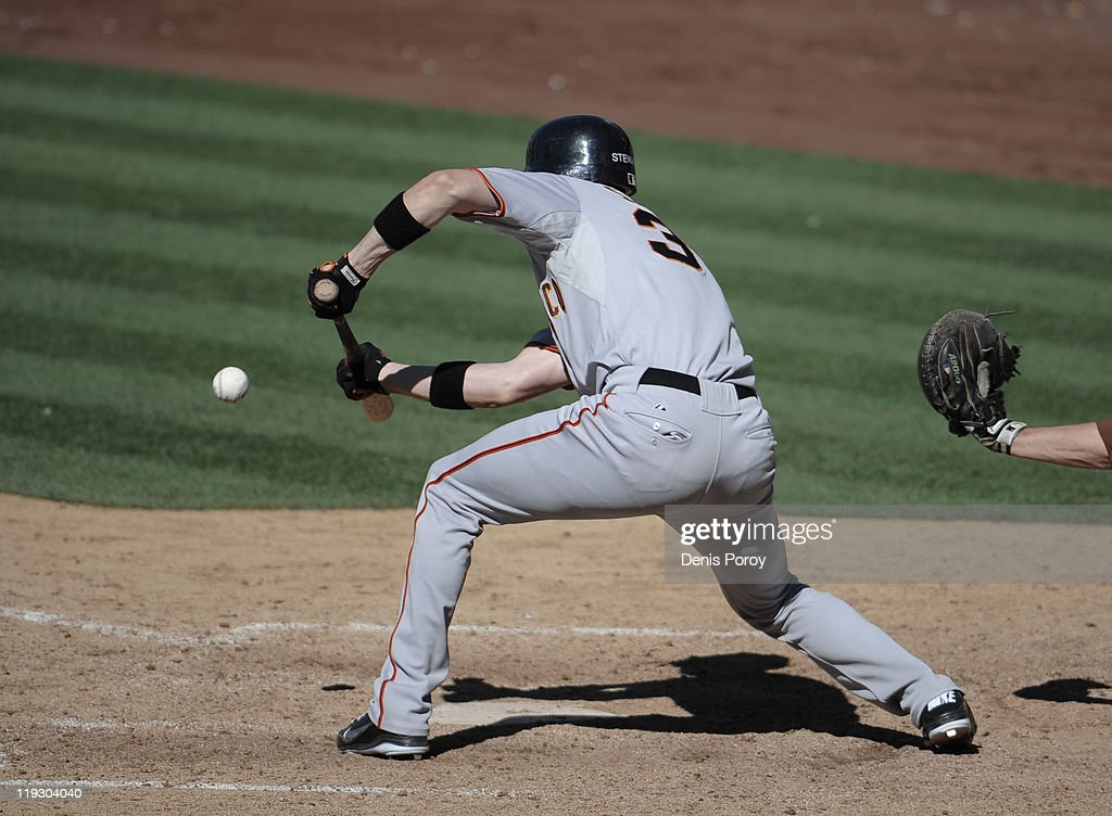 Chris Stewart #37 of the San Francisco Giants lays down a sacrifice bunt during the 11th inning of a baseball game against the San Diego Padres at Petco Park on July 17, 2011 in San Diego, California.